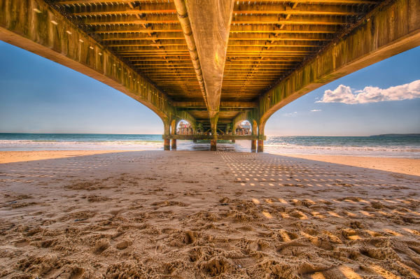 pier with ambient light turning sand blue