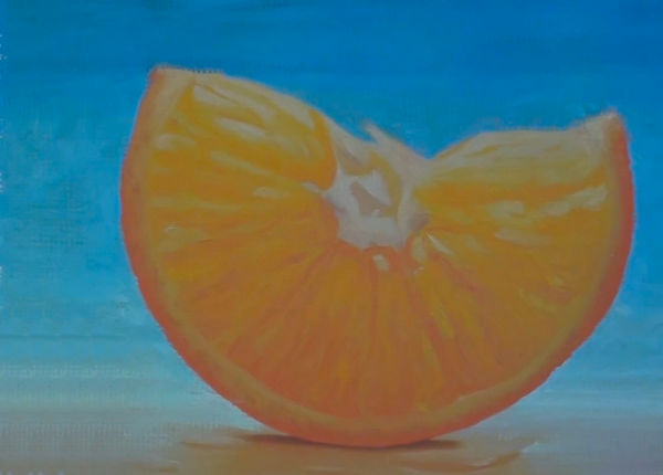 slice of orange painting after adding complementary colours