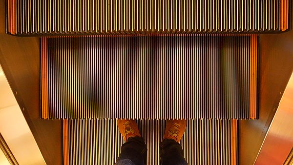 image of an escalator creates sense of movement